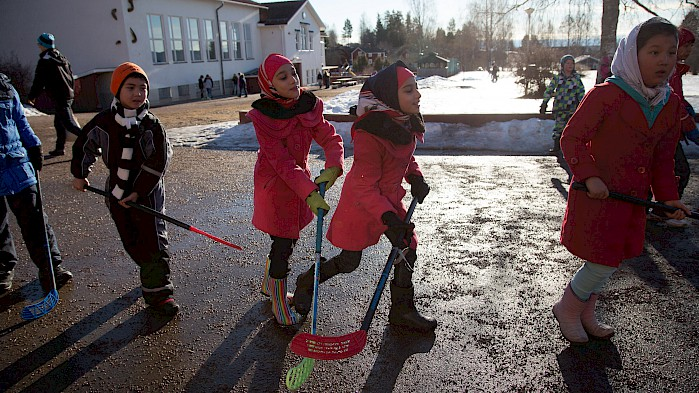 Every child has the right to play. Here, Saghar and Sahar play hockey with other Afghan refugees.